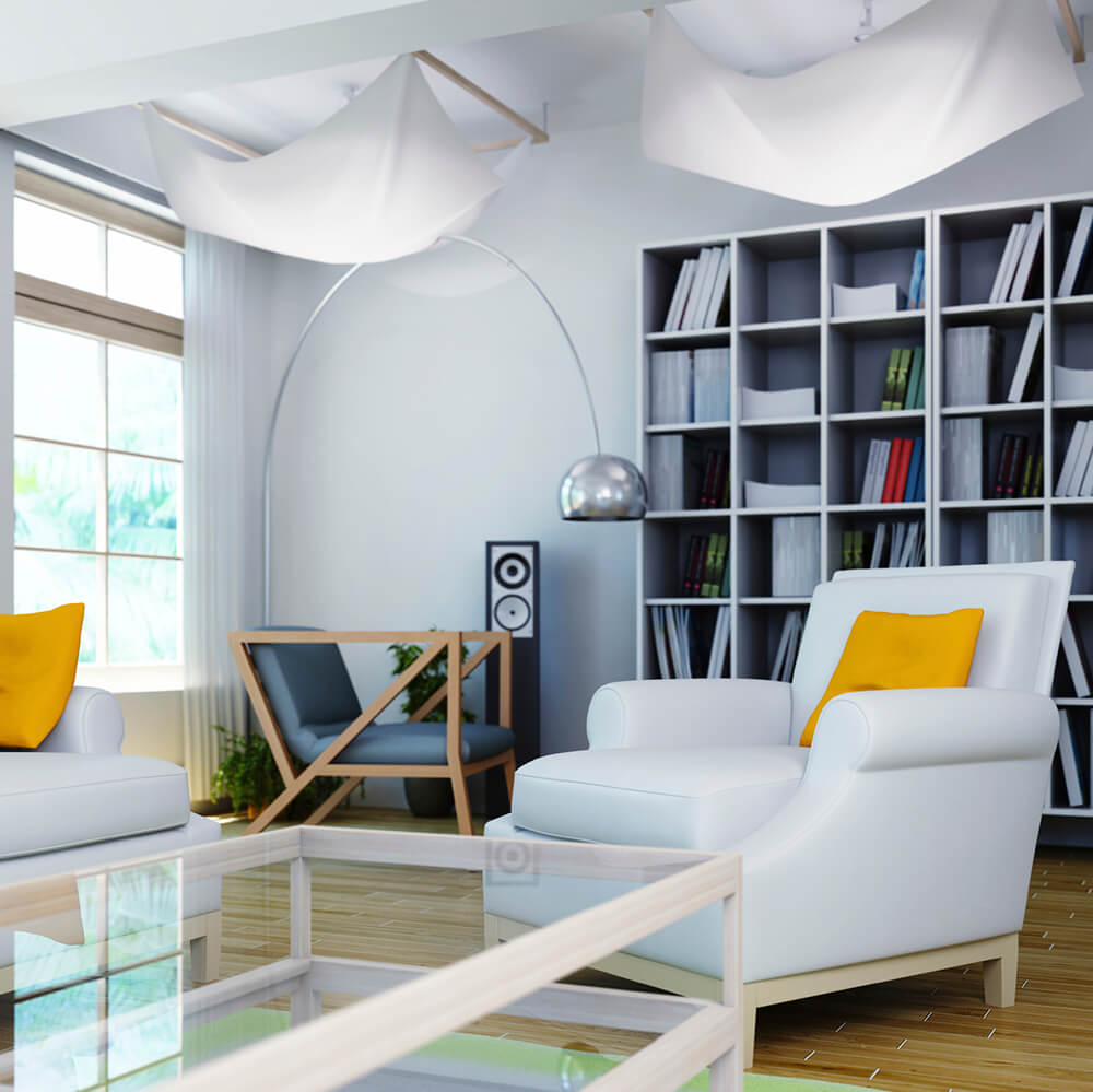 A modern home library with stylish bookshelves and cozy seats set on the home's hardwood flooring.
