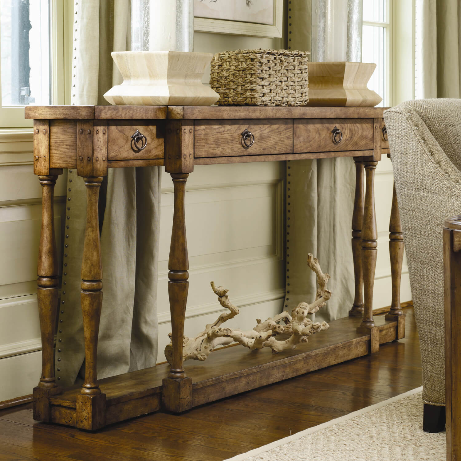 Rivets and other structural elements are visible on this wooden table, which gives it a more dated, rustic feel, while still remaining an elegant carved piece of furniture.