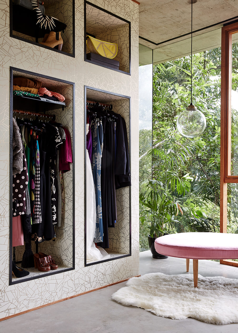 The closet room features a single bear skin rug on the floor, plus textured wall shelving for a kitschy, fun look.
