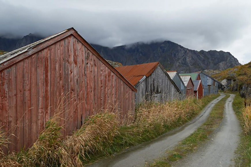 The narrow road leading to the home is dotted with similarly muted homes, in a variety of colors that help them stand out amidst the harsh landscape.