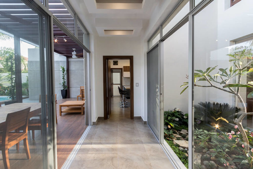 Here is a shot of the signature plumeria tree in the central garden. This hallway leads into the kitchen and laundry room beyond. These halls are centered around the garden, giving the house a pseudo open floor plan.