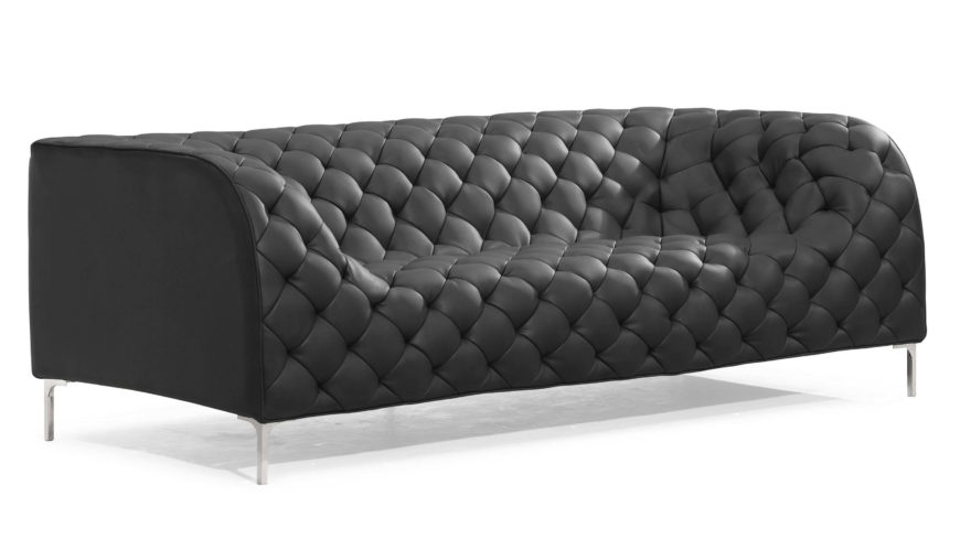 This sofa design is a truly standout example of modern furnishing. The button tufted leather stretches over a gently curving body that erases the lines between back and seat. The texture grants it a classical air that makes for a uniquely timeless appearance, able to complete a traditional or ultra-modern man cave.