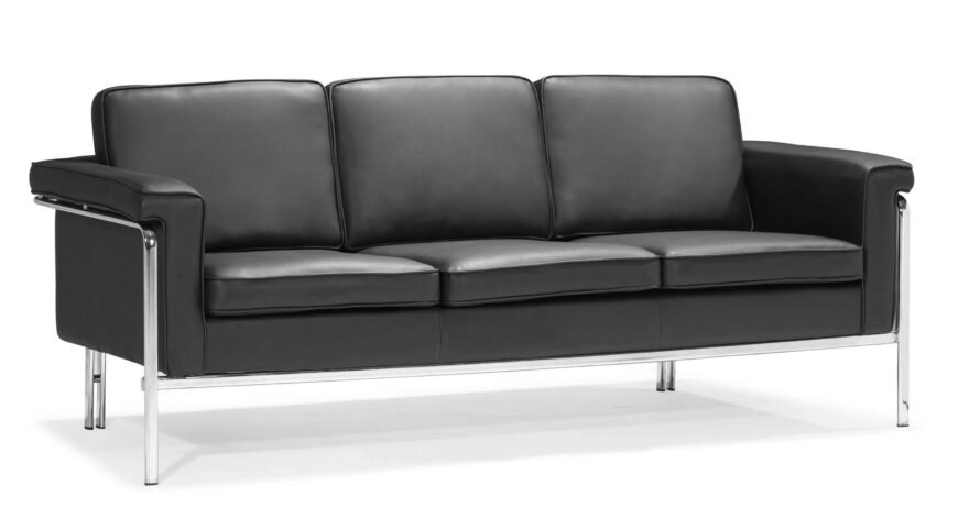 Complementing the prior example, this wider low slung sofa takes the minimalist approach, with simple chromed metal framing and a set of angular but soft leather cushions. It's an elegant but tough look.