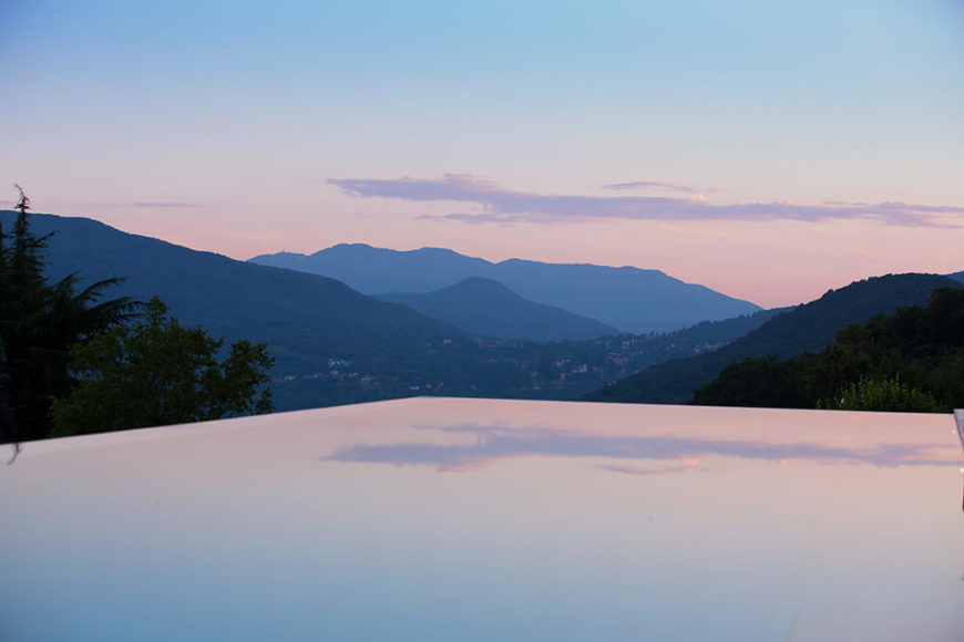 We leave you with a view over the infinity edge pool, immaculately reflecting the warm hazy skies over mountains in the distance.