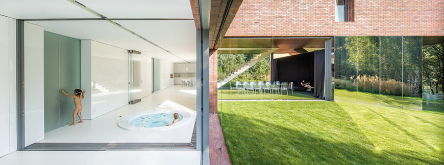 The secluded horizontal section facing the street includes a large, minimalist bathroom area complete with a jacuzzi bathtub. Frosted glass doors provide extra privacy. Entry to the bathroom can be gained through the backyard as well, minimizing the dirt that can be brought into the home.