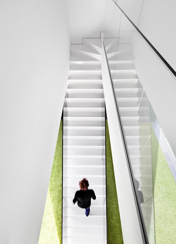Looking down from the second floor, we can see the simple, long staircase that curves to enter the second floor.