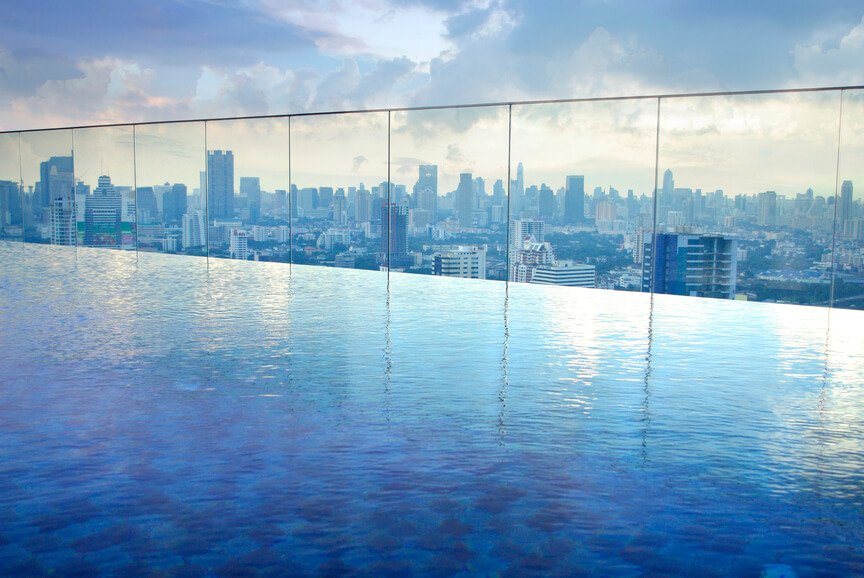 This infinity pool looks like it's on the edge of the world looking out over the cityscape beyond.