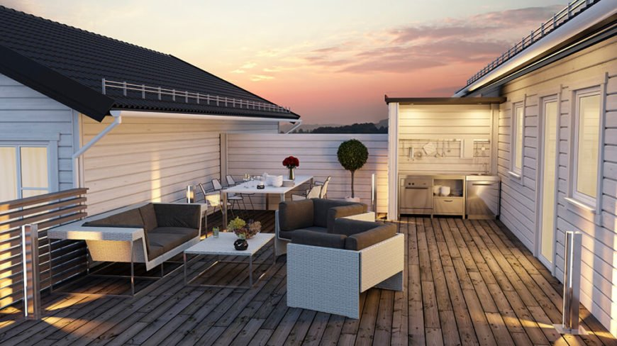 A rooftop patio with a natural hardwood deck, contemporary furniture, and a small outdoor kitchen tucked into a nook.