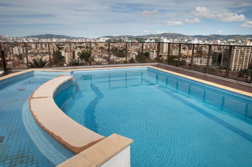 This beautiful pool, with its swooping divider, is a quiet spot in the middle of a bustling city to relax and unwind. The tinted glass railing surrounding the rooftop allows you to see the surrounding cityscape while you enjoy the pool.