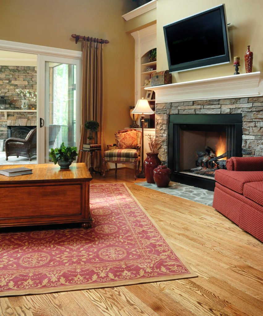 This romantic fireplace mimics the classic stone mantle. It stands tall beneath a flat screen secured safely above the cream colored mantle shelf.