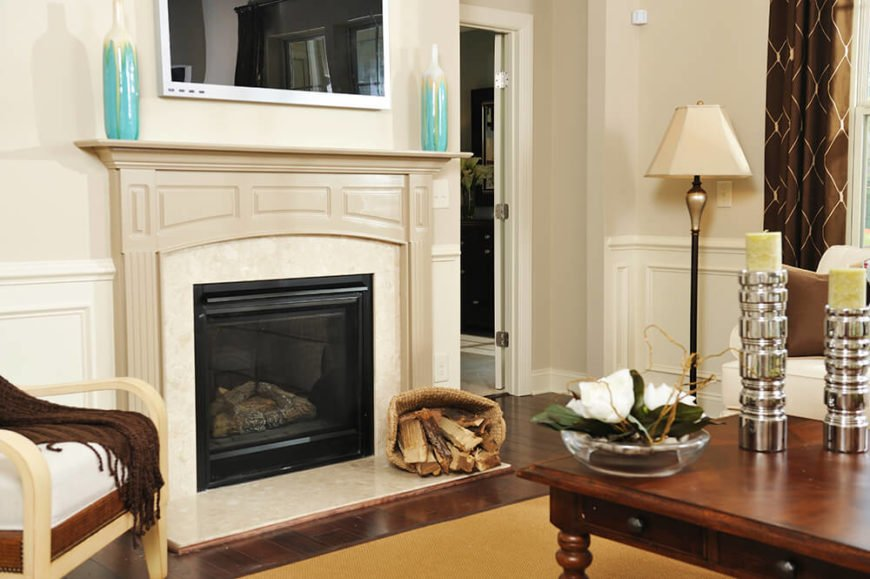 Wood and marble work together flawlessly in this incredible fireplace. The mantle and the hearth make a great partner along with the television mounted just above the mantle.