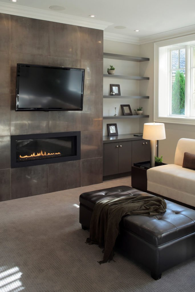 This modern touch on a mantle and television setup is extremely elegant. The unique shape of the fireplace adds a bit of shape and contrast to the walls around it.