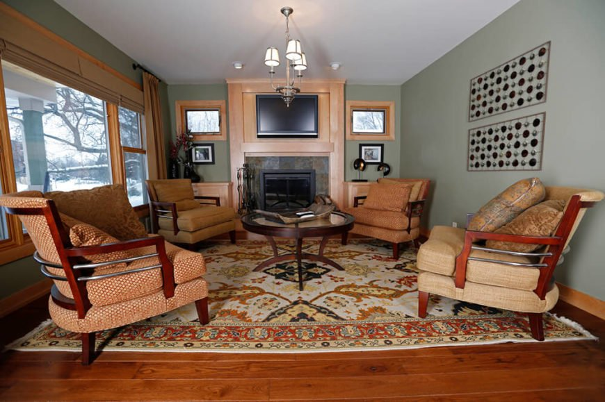 This traditional living room doesn't settle with a completely rustic theme. Along with the gorgeous mantle, they add a television for that kiss of modern technology.