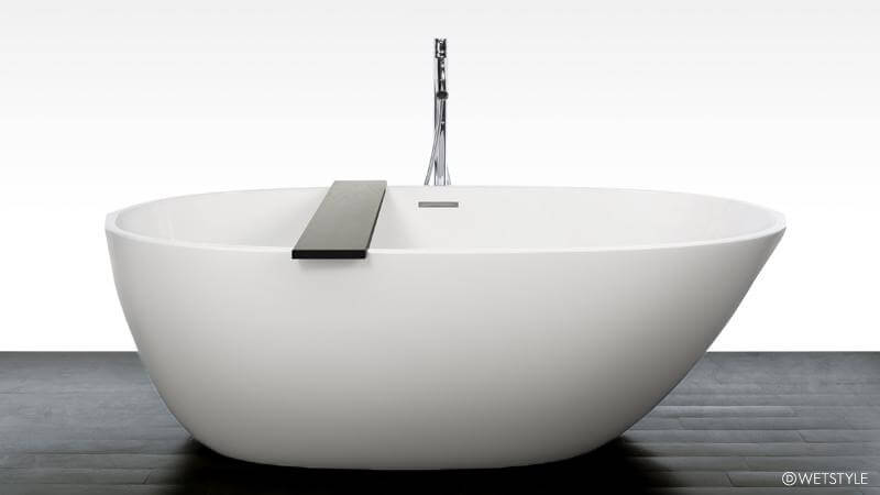 The BBE o1 bathtub from WETSTYLE's Be Collection is inspired by nature, the asymmetrical shape of the free standing bathtub inspired by the shells of exotic fruits, much like a mango. The BBE 01 bathtub comes with a wenge-colored bathtub caddy and is available in matte or True High Gloss™, or in a dual finish.