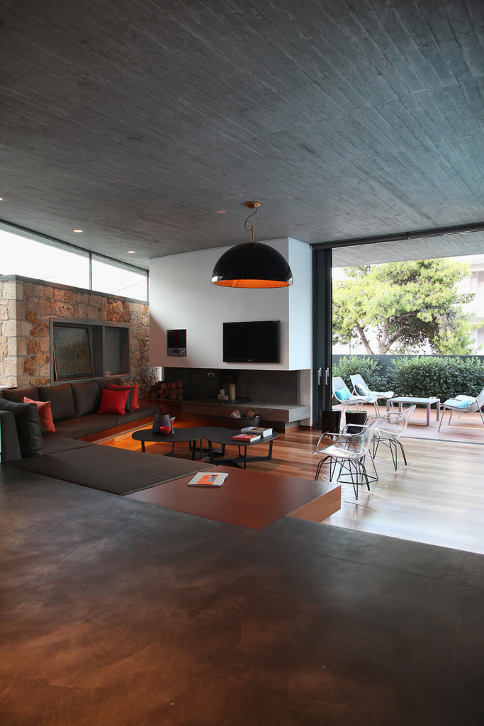 Smooth, treated concrete floors create the raised area of the main floor. This area extends into the other sections of the living space like the kitchen and dining areas.