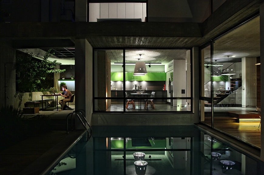 The kitchen, dining area, and outdoor eating area can all be viewed, lit up for a special visual treat. Even one of the open spaces on the second floor can be viewed here, aglow from the inside.