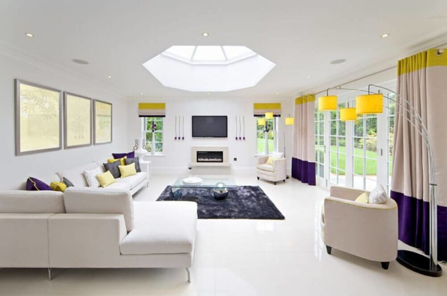 The accent colors are used a little more subtly in this living room, which features bright yellow at the top of the room and royal purple near the floor.