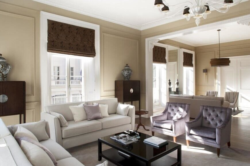 This enormous living room is separated by a single wide archway, which makes it easy to separate the rooms into two distinct seating areas.