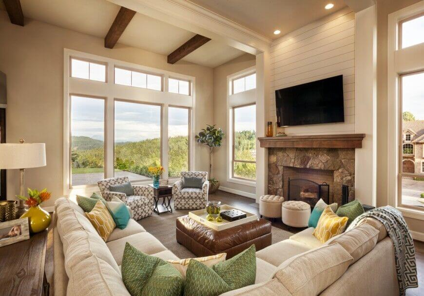 In a contemporary setting wrapped in off-white and grounded by rich hardwood flooring, the double height ceiling adds some fine contrast with dark exposed wood beams. Tall windows allow for an open, airy look.