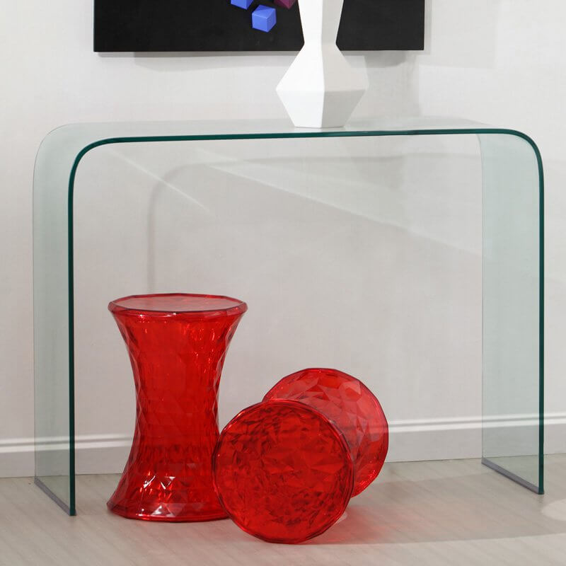For an ultra-modern and minimalist design, look no further than this all-glass curved console table.
