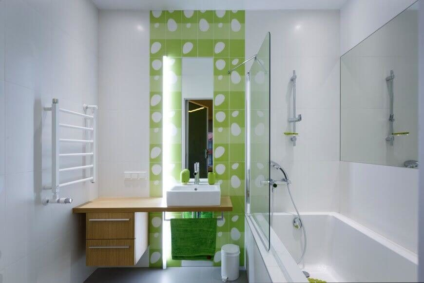 Bright green accents stand out in this modern minimalist bathroom. Against the light wood used in the vanity the green adds a very lively touch to the room - balancing the use of white and the dark grey tile floor.