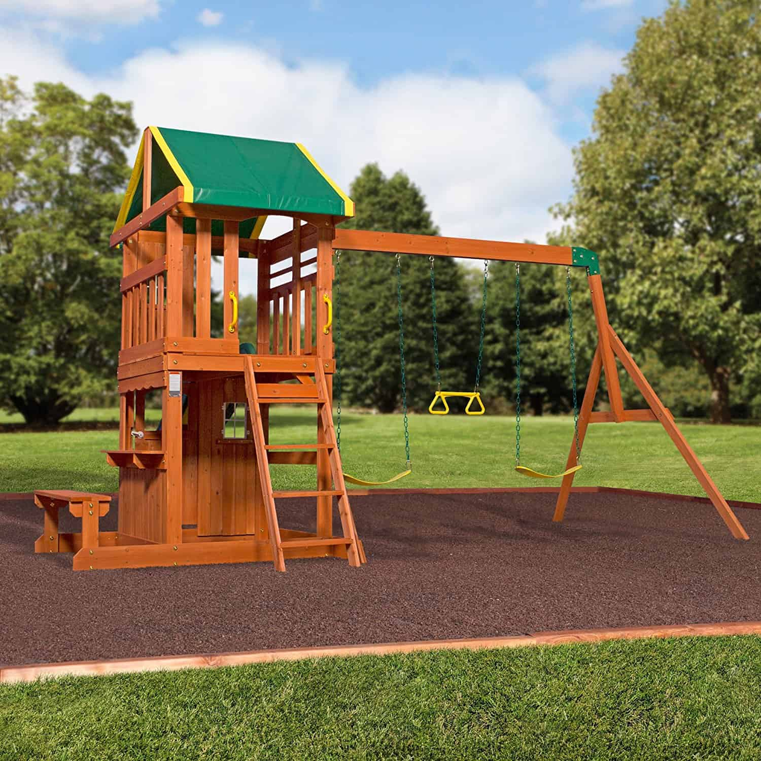 Smaller backyard playground with elevated fort and swing set.
