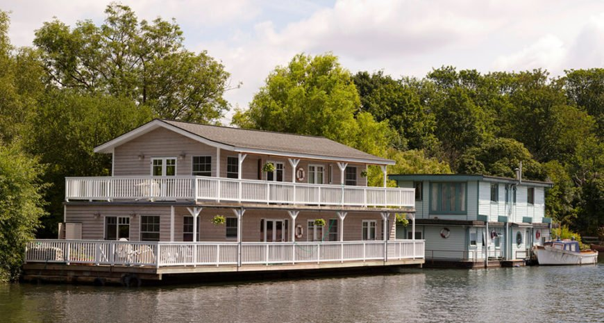 This is an incredibly massive houseboat that could be larger than many landlocked homes. Two wraparound porches frame the home.