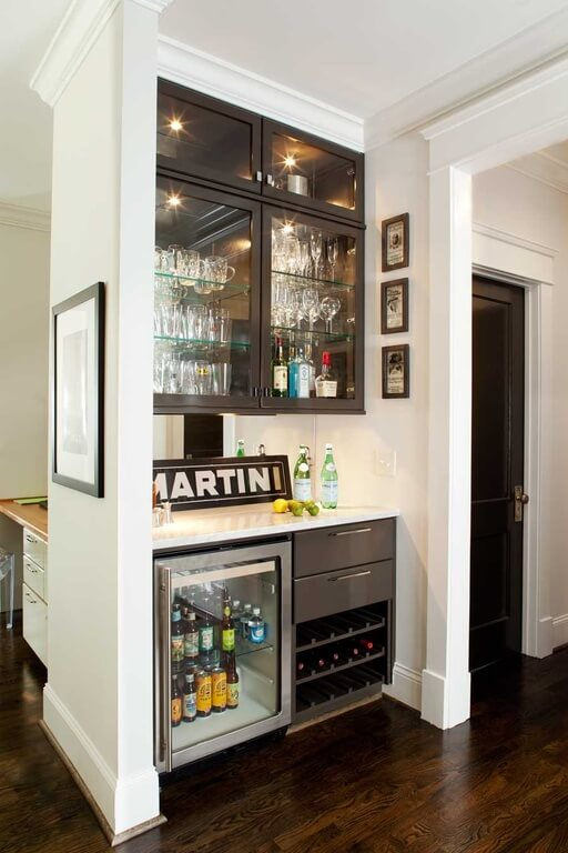 This home features a small bar counter with charming cabinetry.