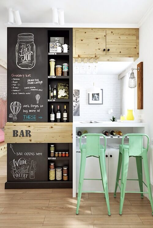 This home features a small bar with stylish shelving and counter set on the hardwood flooring.