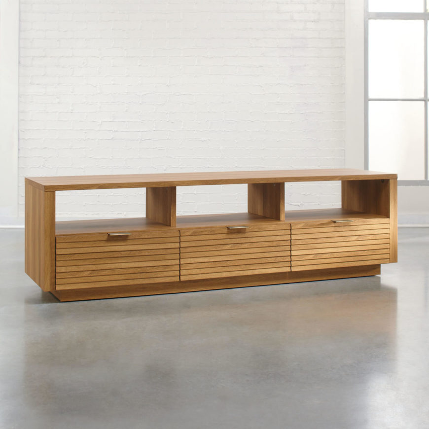 This elegant, modern natural oak set boasts a simple, minimalist design that offers abundant utility and gets out of the way. A piece like this can be used simply as a TV stand, but can also supply abundant display shelving above its storage when you have the TV itself mounted on the wall above.