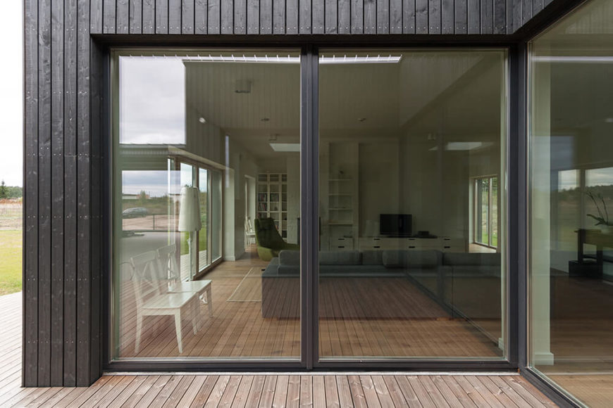 While these glass panels do not slide open, they certainly will let in some natural light for the living room, and help to open the inside of the house more by providing a wide view of the outdoors and patio area.