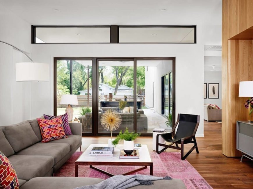 The living room is naturally lit via a broad spectrum of windows and sliding glass doors. Here we can see the vast patio, with its own set of relaxing furniture and wet bar.