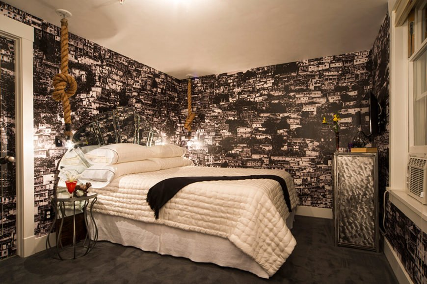This bedroom is wrapped in the Favela wallpaper, making for a sharply textural appearance with a sense of playfulness, despite the black and white palette.