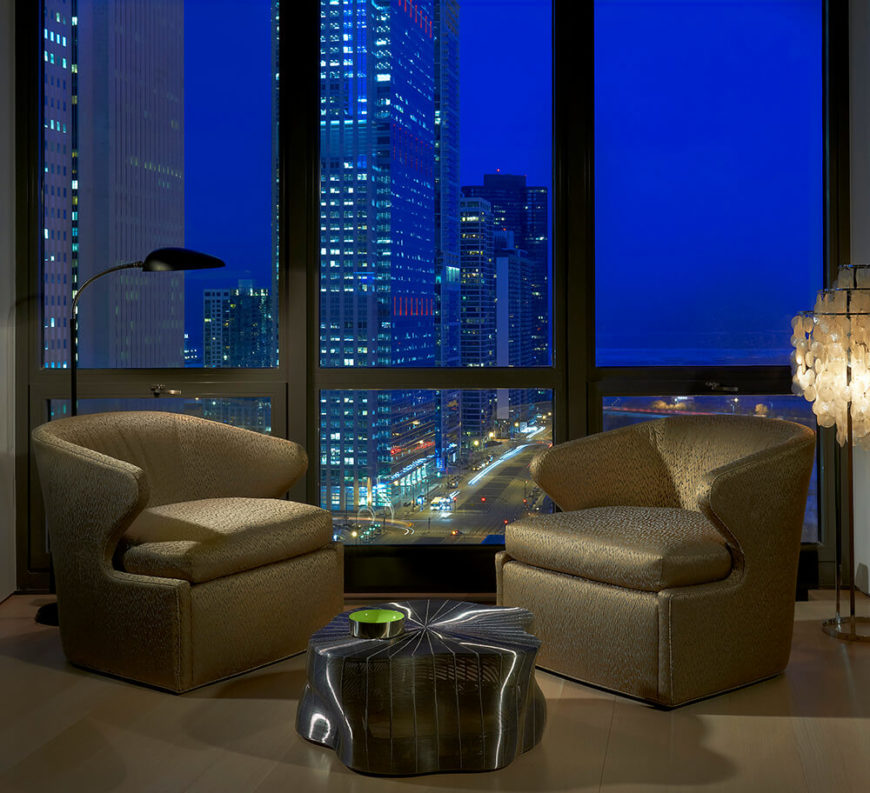 A view of the secondary seating area nearest the wall of windows that look out on Millennium Park. The bright lights of the city below are intoxicating.