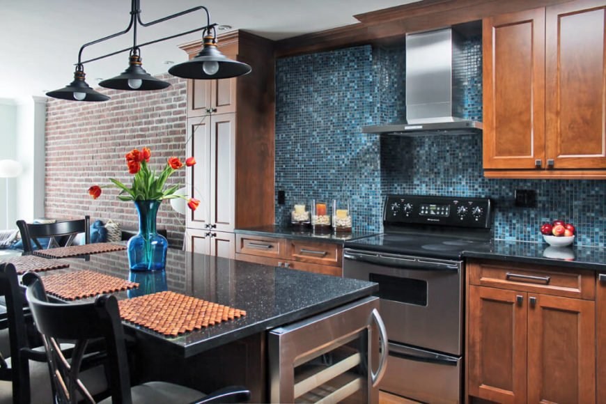 Kitchen with walnut cabinetry and granite countertops along with unique backsplash.