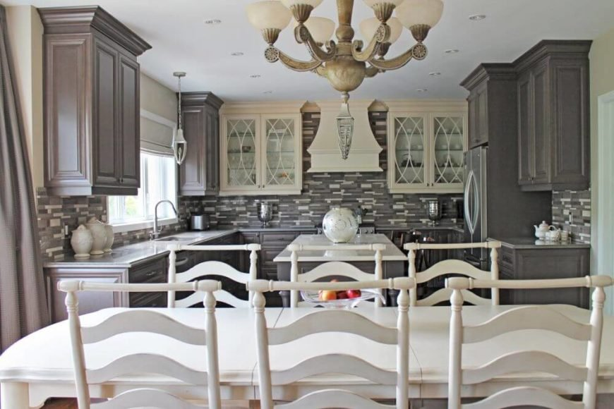 Florence inspired kitchen with a center island and a dine-in table set.