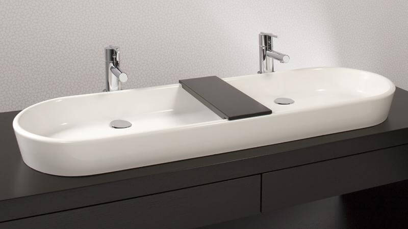 The longest sink in the Ove Collection features two faucets and drains with an optional divider between the two. The sheer size of this sink makes it desirable for bathrooms with space to spare. This sink requires wall or countertop plumbing installation and is available in True High Gloss™ or matte finishes.