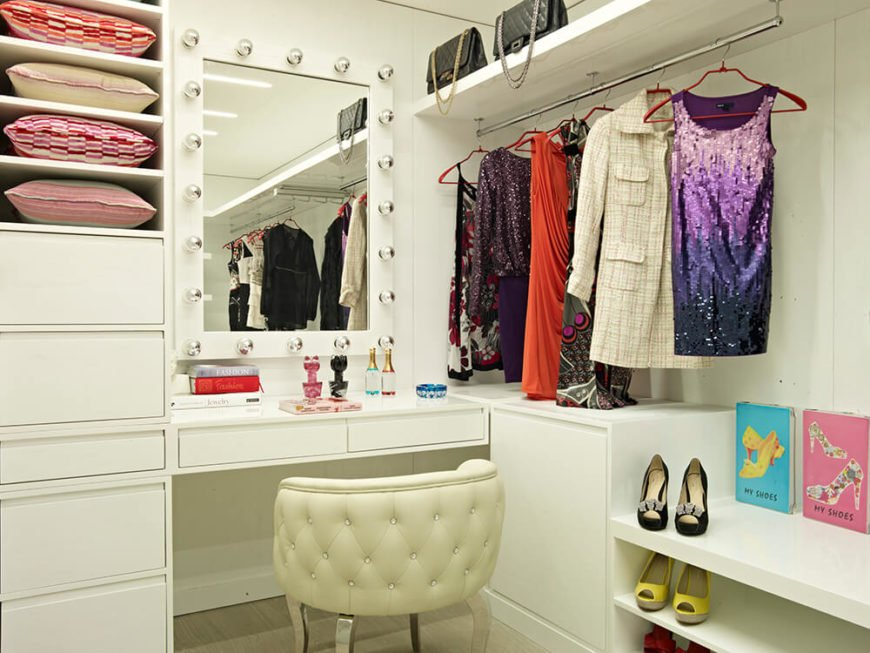This space includes a full makeup desk and mirror, perfect for getting ready for the day. The shelving doubles as an elegant display system.