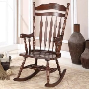 A wooden rocking chair.
