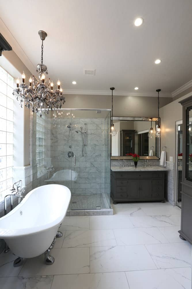 Contemporary master bathroom with a classic clawfoot tub next to an all-glass corner shower.