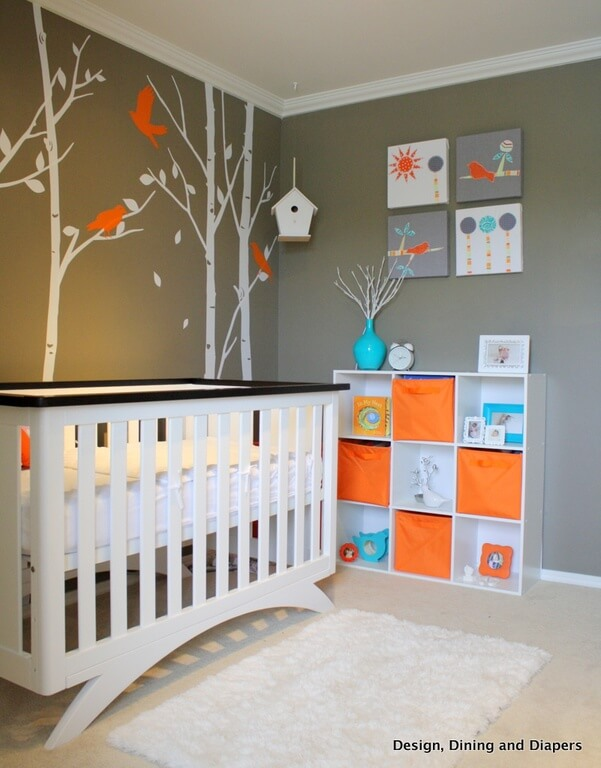 Contemporary nursery room with stylish wall design and a classy carpet flooring with a rug.