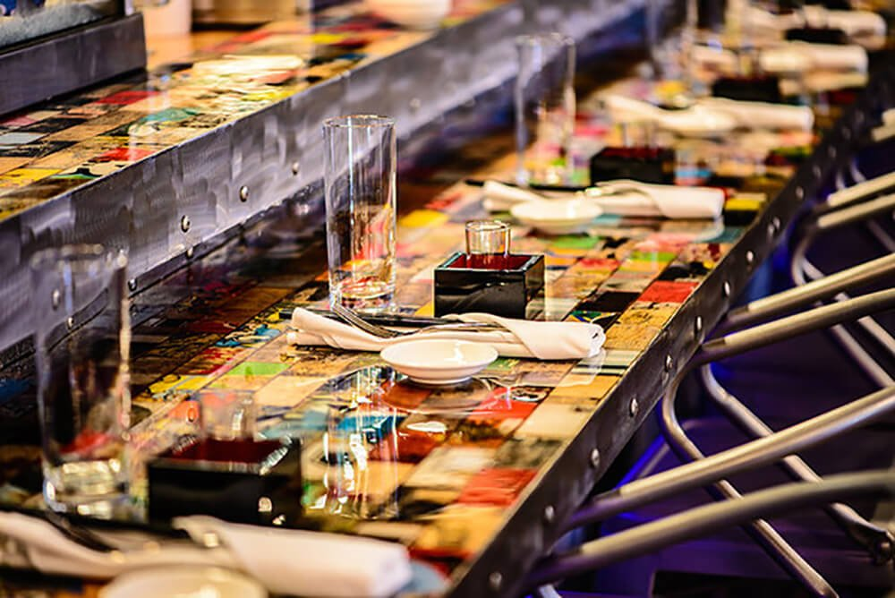 In the Eight Sushi and Asian Kitchen in Charlotte, NC, they have a full dining and serving table with board art as the surface. Those who enjoy sushi and fine cuisines will know that presentation has a tremendous effect on the meal. The fact that they have chosen board art as the surface for their customers to dine on shows that this art is not just for skating enthusiasts and art geeks, it is a creative new way to design any kind of space!