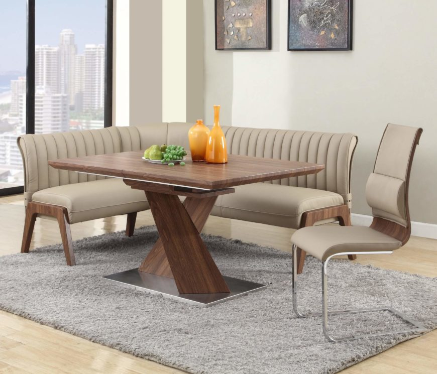 This relatively compact corner dining set combines rich hardwood construction and walnut finish with sleekly cushioned seats, upholstered in light beige faux leather. The table itself is strong and stately, with a criss-cross pedestal base that stands apart aesthetically and functionally.