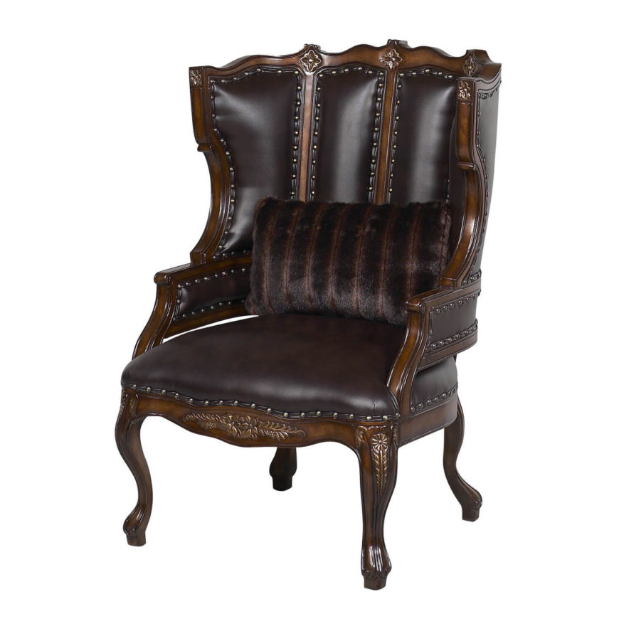 This gorgeous, medieval looking chair is carved from solid mahogany and upholstered in dark brown leather. Made in the USA, this traditional design features extraordinarily fine detail, from the reinforced frame to the gentle curves adorning the top and sides of the chair. This incredible piece is perfect for dark, rich color schemes or similarly historical decor.