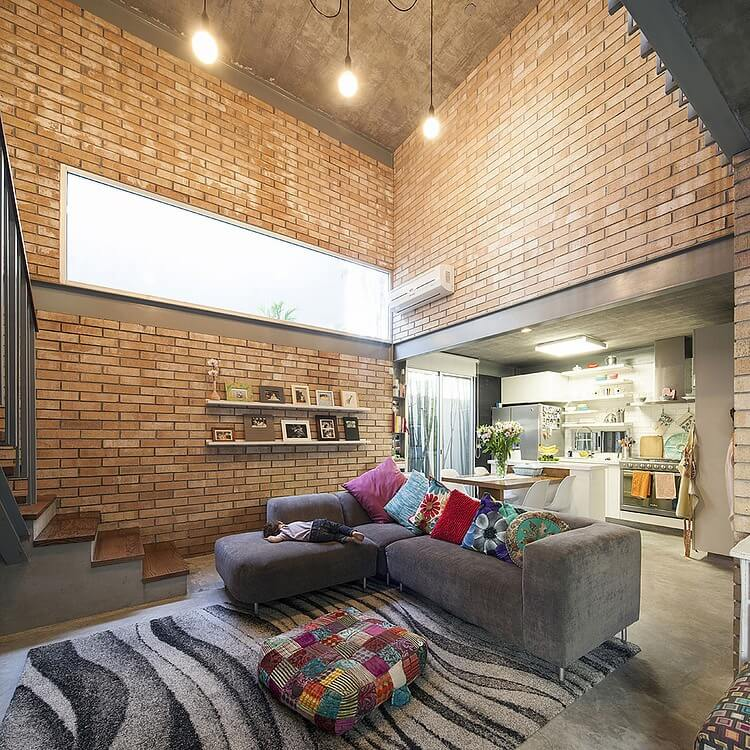 Providing strong, clean lines, brick is great at forming noteworthy vaulted ceilings and combining floors without the hassle of wooden or drywall seams.