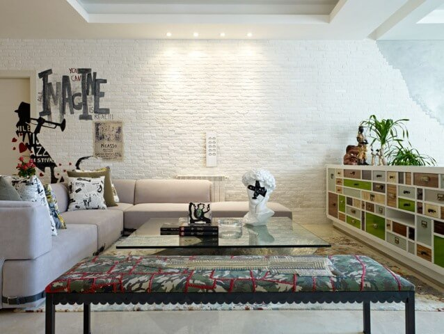 Brick walls invite you to be as inventive as possible, providing a stable backdrop in which to unleash your creative impulse upon the blank canvas. The white wall in the above example helps the colors and patterns in the rest of the room come alive.