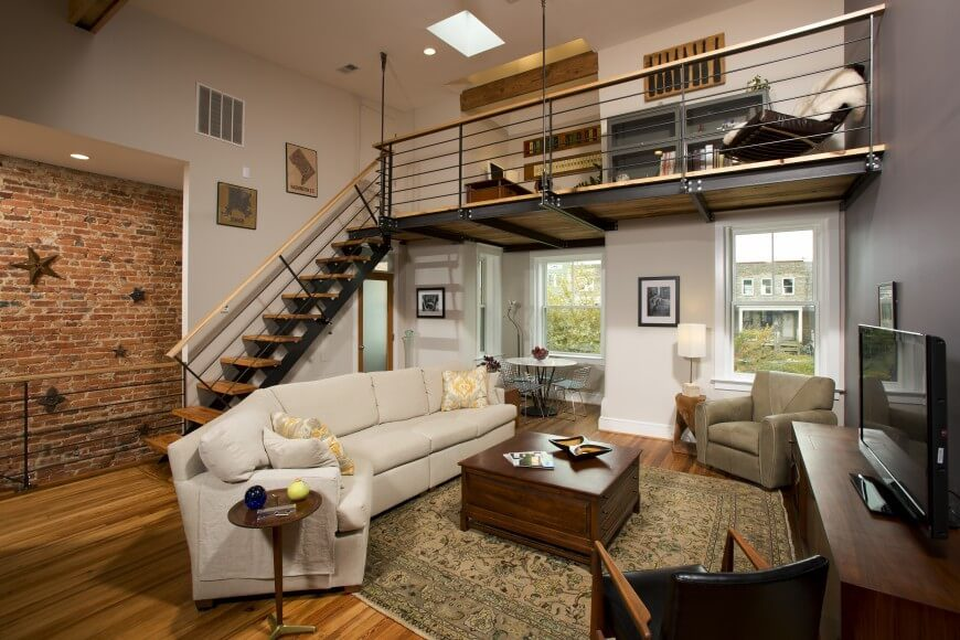 Brick in one room can serve to accentuate the view in another, adjacent rooms. In this example, the loft empties into the living room next to the brick wall - essentially giving you more bang for your decorative dollar.