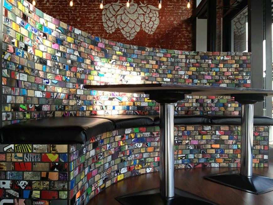 At the Miscreation Brewing Company in Hanover, PA., Art of Boards has designed sectional booths and a section of wall with their unique board art tiles. Customers can get up close and personal with this design, and being that many people will be moving in and out of this booth, its apparent that the tiles are designed to withstand wear and tear.