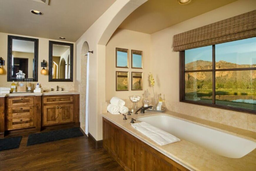 Wood Framed Window Next to Tub with Roll-Down Blind