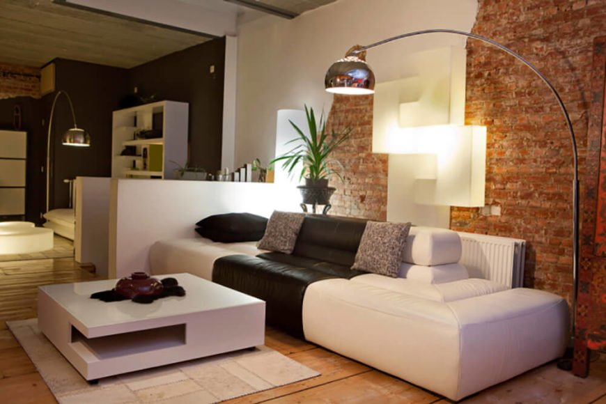 Modern living room with exposed brick wall.